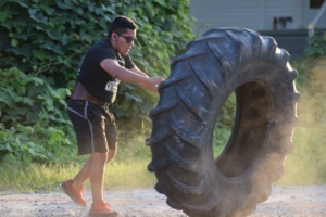 Man flipping large tire at a Big Lift Club at Matthew's Gym in Forest City, NC