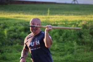 Man throwing javelin at a Big Lift Club at Matthew's Gym in Forest City, NC