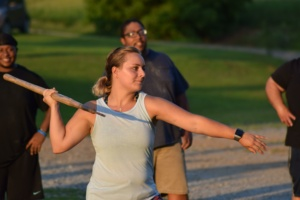 Woman throwing javelin at a Big Lift Club at Matthew's Gym in Forest City, NC