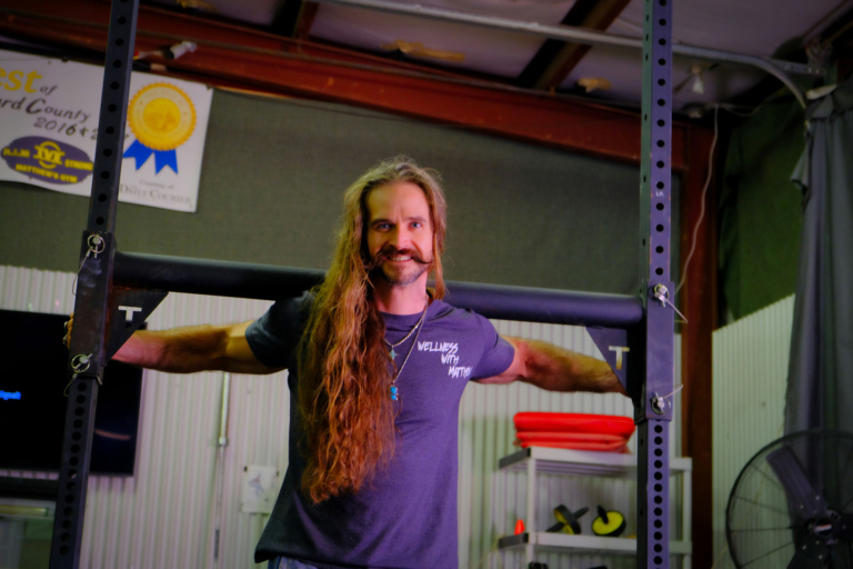 Matthew Short smiling at camera, pictured as a certified personal trainer at Matthew's Gym