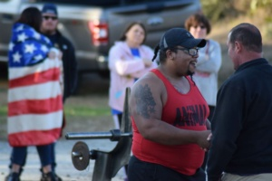 Men shaking hands during a Strongman and Strongwoman competition at Matthew's Gym in Forest City, NC