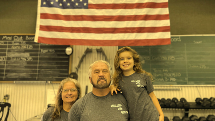 Members of the Short Family pictured at Matthew's Gym in front of American Flag